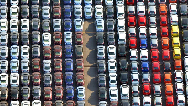 In this January 2017 photo, cars are parked waiting to be exported at Yokohama port near Tokyo. Japan's government has warned in a report that a higher U.S. tariff on auto imports could backfire, jeopardizing hundreds of thousands of American jobs created by Japanese auto-related companies, raising prices for U.S. consumers and devastating the U.S. and global economy.