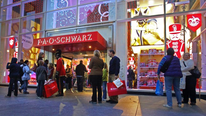 Toys R Us is closing its iconic FAO Schwarz store, citing the high and rising costs of running the retail space on New York City's pricey Fifth Avenue, the company said Friday. FILE - In this Nov. 21, 2011, file photo, shoppers stand outside of FAO Schwarz in New York. Toys R Us is closing its iconic FAO Schwarz store, citing the high and rising costs of running the retail space on New York City's pricey Fifth Avenue, the company said Friday, May 15, 2015. (AP Photo/Bebeto Matthews, File)