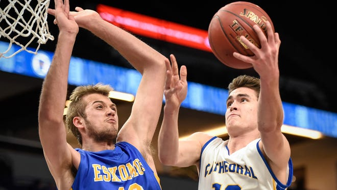 St. Cloud Cathedral's Mitchell Plombon takes a shot over Esko's Adam Trapp during the first half Wednesday, March 21, in the first round of the state Class 2A boys basketball tournament at Target Center in Minneapolis.