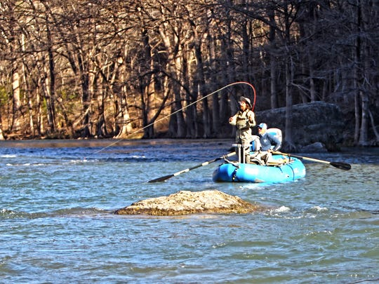 Troy Nixon demonstrates his casting prowess while Chris Jackson maintains a steady course on the Guadalupe River.