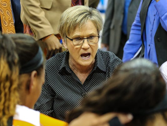 FILE- In this March 5, 2016, file photo, Tennessee head coach Holly Warlick speaks with her team during an NCAA college basketball game against Mississippi State in the Southeastern Conference women's tournament semifinal in Jacksonville, Fla. Tennessee heads into the NCAA Tournament embracing its unfamiliar role as a potential underdog. After a disappointing regular season Tennessee is seeded seventh in the Sioux Falls Regional on Monday, March 14, 2016. (AP Photo/Gary McCullough, File)