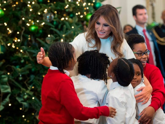 Melania Trump hugs children in the East Room as she