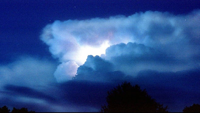-  -Lightning flashes inside a cloud as a thunderstorm moves through the starlit sky north of Palestine, Texas, Wednesday, July 1, 1998. (AP Photo/Palestine Herald-Press, Joel Andrews)