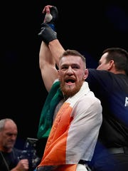 Conor McGregor of Ireland celebrates his knockout victory over Eddie Alvarez of the United States in their lightweight championship bout during the UFC 205 event at Madison Square Garden on November 12, 2016 in New York City.