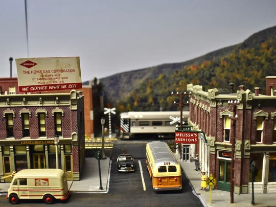 A passenger train crosses Main Street in Canaan, Connecticut  in David Todd Magill's basement display.