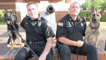 (L-R) K-9 Nash, Officer Patrick Kelly, Officer Harry Barraclough and K-9 Zuul