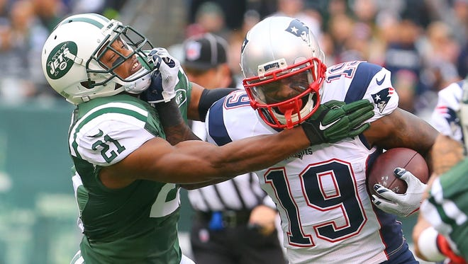 Brandon LaFell offers a stiff arm last year against the Jets. He joins the Bengals claiming full recovery from a foot injury that made for a down 2015 season.