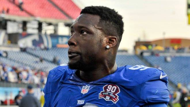 New York Giants defensive end Jason Pierre-Paul (90) leaves the field after his team defeated the Tennessee Titans 36-7 during the second half at LP Field.