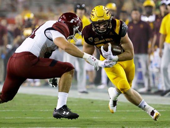 Arizona State's Nick Ralston runs the ball against