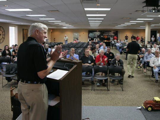 Hall of Fame auctioneer Bill Sheridan is shown during an auction for the Mitchell Museum Aug. 20, 2014, in Owosso.