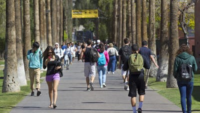 President Michael Crow says ASU will freeze tuition for in-state undergrads, grad students.