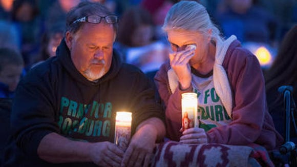 Residents of Winston, Ore., at a candlelight vigil