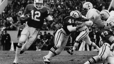 Kentucky's quarterback Derrick Ramsey looks for a hole as Steve Campassi (41) provides some blocking in their game with Tennessee at Lexington. Nov 22 1975