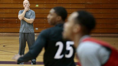 University of Cincinnati coach Mick Cronin watches practice Thursday at Trinity College in Hartford, Connecticut.
