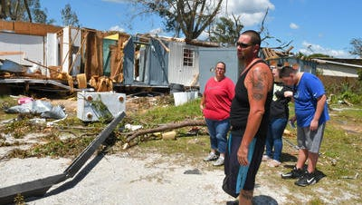 Lisa and David Justice, from left, and two of their five children, Hayley Ellenburg and David, Jr., stand by their manufactured home in Mims, which was destroyed from an apparent tornado spawned by Hurricane Irma. Several other nearby homes were damaged.   Lisa and David Justice and their five children had their manufactured home in Mims destroyed from a tornado spawned by Hurricane Irma. Several other homes were damaged by this same tornado.