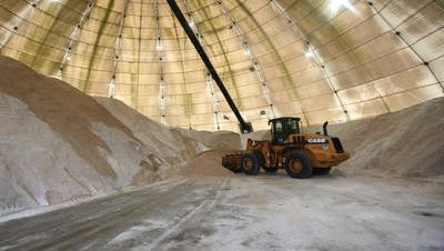 A bulldozer moves salt around Monday inside Cincinnati's salt dome in Sayler Park. The dome is usually full by now, but this year it is only about 30 percent full because of a national salt shortage.
