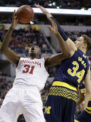 Indiana Hoosiers center Thomas Bryant (31) and Michigan Wolverines forward Mark Donnal (34) fought for a rebound in the second half of their Big Ten Men's Basketball Tournament game Friday. The Indiana Hoosiers lost to the Michigan Wolverines 69-72.