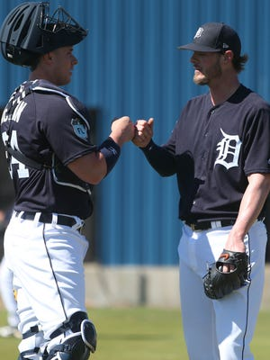 Detroit Tigers catcher James McCann talks with pitcher Mark Lowe at Tigers Spring Training on Thursday, Feb. 16, 2017 at Publix Field at Joker Marchant Stadium in Lakeland, Fla.
