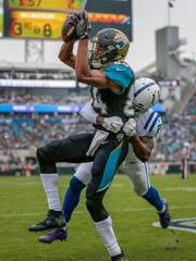 Jacksonville Jaguars wide receiver Keelan Cole (84) pulls in a touchdown catch over Indianapolis Colts cornerback Nate Hairston (27) at EverBank Field on Sunday, Dec. 03, 2017.