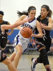 Falcon forward Caitlyn Albright pushes past Red Tornado defender Briana Perry.