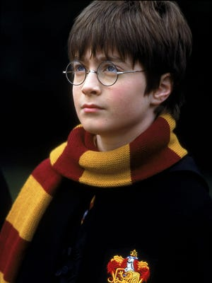 Daniel Radcliffe plays Harry Potter in a scene from 'Harry Potter and the Sorcerer's Stone.'