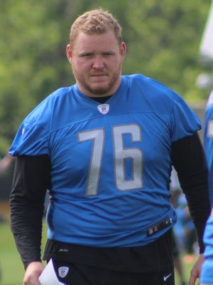 Brother Rice graduate T.J. Lang is learning on the fly for the Detroit Lions after having spent his first eight seasons as an offensive lineman for the Green Bay Packers.