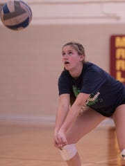 Sophomore Kayla Shields helps Mercy's defense from