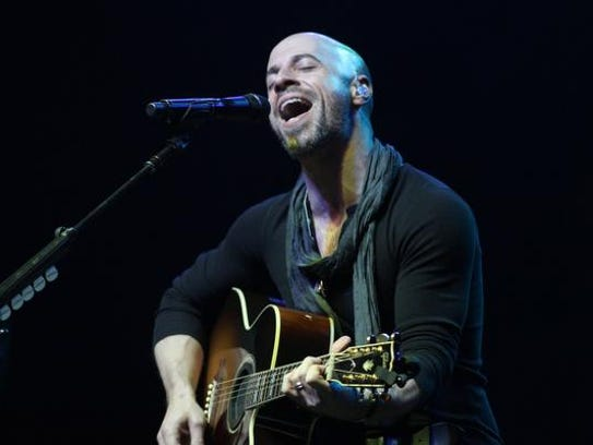 Artist Chris Daughtry performs on stage in 2013, in