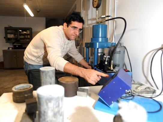 Hamid Akbari conducts pressure tests on some coal ash