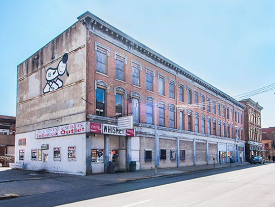 A former liquor store and largely vacant building known