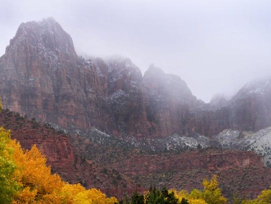 Snow frosted the red tips of the peaks above Zion National