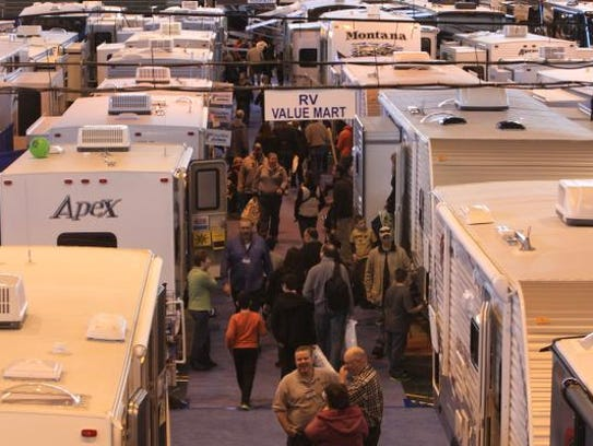 People look over the many recreational vehicles on