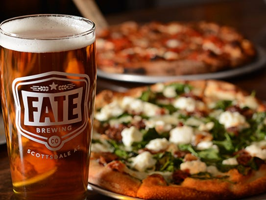 Fate Brewing serves pizza, along with small bites,