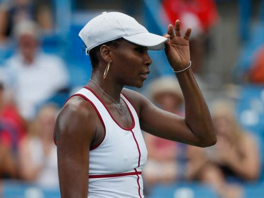 Venus Williams reacts during a middle round match against