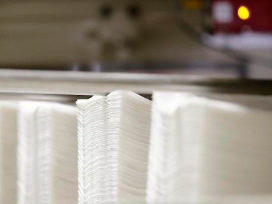 Napkins are shown in the production line at a Georgia-Pacific
