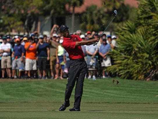 Tiger Woods plays from the fairway of the 3rd during