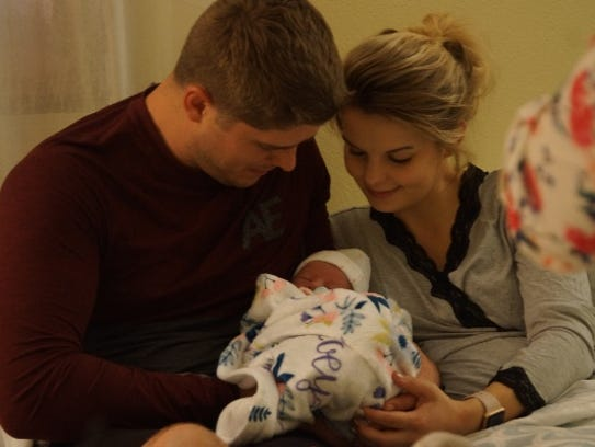 John and Alyssa Webster hold their daughter Zoey Joy