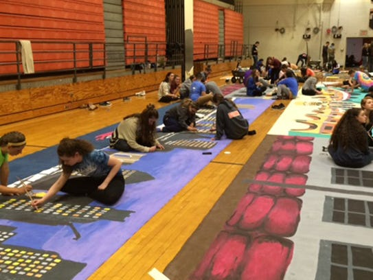Students work on a mural for Pennsbury prom.