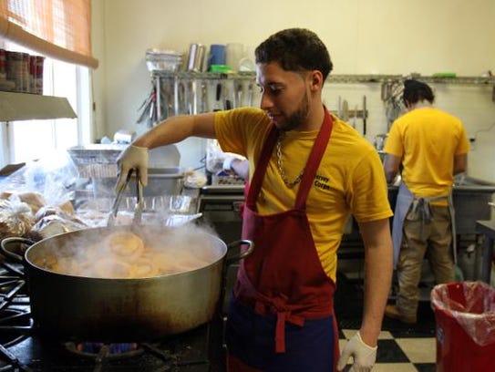 Anthony Cocuzza  volunteers his time to help prepare