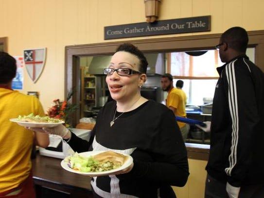 Volunteer Jacqueline Butler serves lunch at St. Mark's