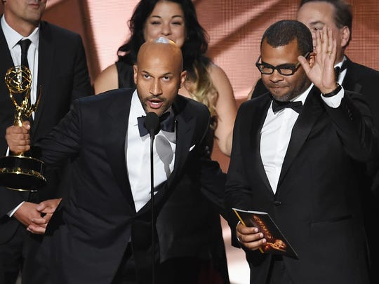 "Actor/writers Keegan-Michael Key, left, and Jordan Peele accept Outstanding Variety Sketch Series for ""Key & Peele"" during the 68th Annual Primetime Emmy Awards at Microsoft Theater on Sunday in Los Angeles"