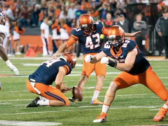 Illinois placekicker Chase McLaughlin (43) makes a field goal as quarterback Cam Miller (14) holds during the first quarter of an NCAA college football game against Western Kentucky, Saturday, Sept. 9, 2017, in Champaign, Ill. (AP Photo/Bradley Leeb)