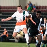 Bucks player Adam Najem (right) races by a Pittsburgh Riverhounds player.
