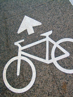 A road marker in a bicycle lane.