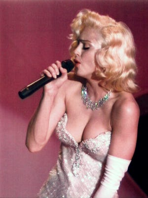 """1991: Madonna performs """"Sooner or Later (I Always Get My Man)"""" from the motion picture """"Dick Tracy"""" during the Academy Awards."""