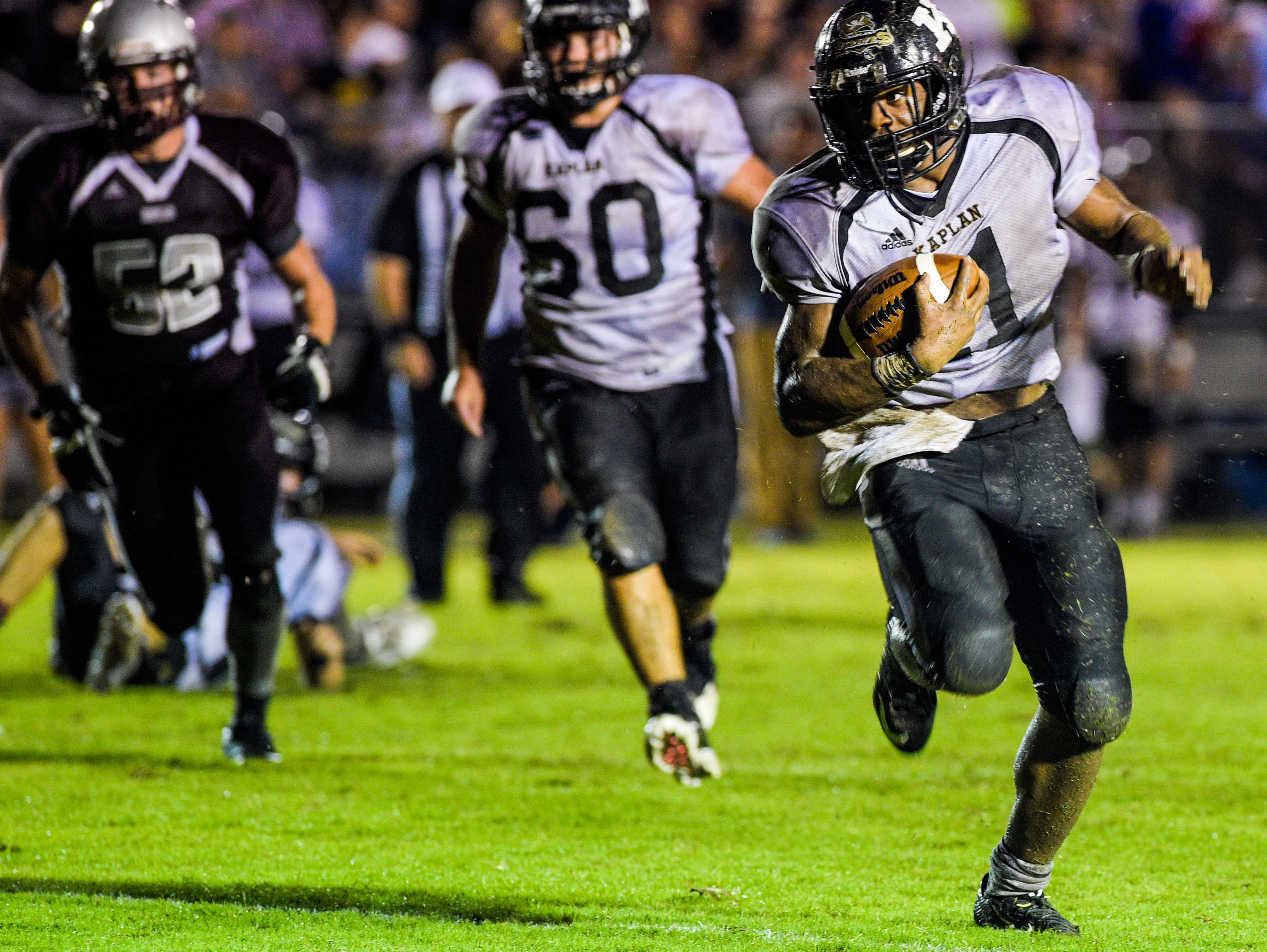 Kaplan running back Julius Johnson (11) runs for a touchdown during an LHSAA football game at Vermilion Catholic High School Friday, Sept. 11, 2015.