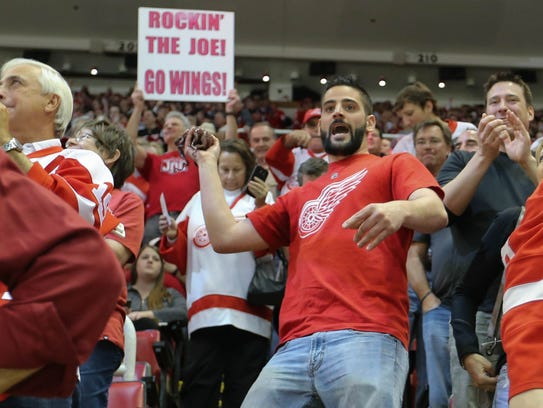 A Red Wings fan throws an octopus on the ice after