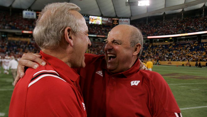 Wisconsin coach Barry Alvarez gave a hug to booster Ted Kellner after the Badgers' improbable victory over Minnesota in 2005.
