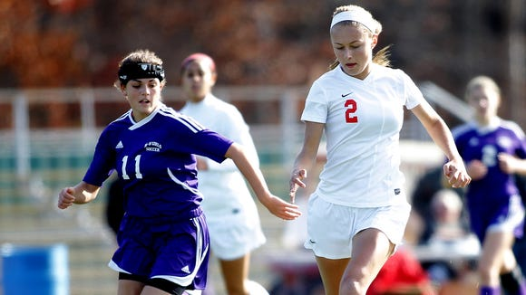 North Rockland's Taylor Aylmer (2) works the ball against Monroe-Woodbury's Brianna DeLeo (11) during the first half of the girls Class AA regional final at Arlington High School in Arlington Nov. 9, 2014.