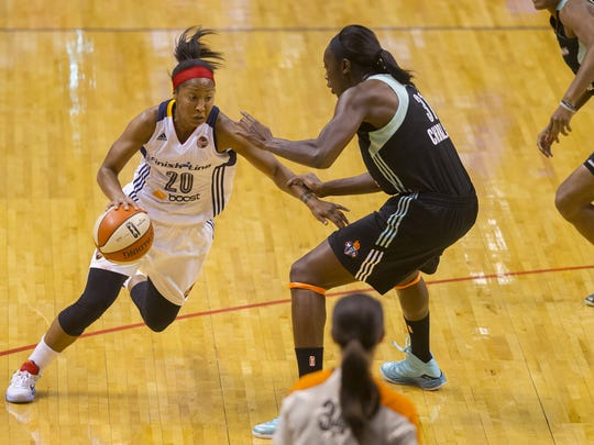 Indiana Fever guard Briann January (20) drives the ball into the lane against New York Liberty center Tina Charles (31) during the second half of a WNBA Eastern Conference Finals game, Sunday, September 27, 2015, at Bankers Life Fieldhouse in Indianapolis. The Fever won, 70-64.